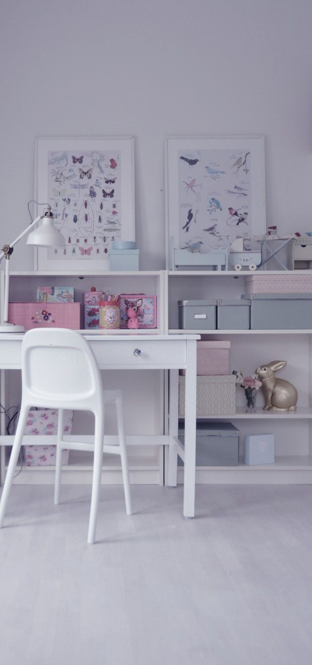 interiors. butterfly and bird prints. child's writing desk. white floorboards.