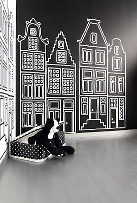 hmmm....chalkboard paint on a magnetic wall...dollhouse?  garden? town scape with streets and parking lots?
