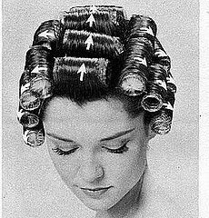 This is the right way to put hair in rollers. My late mom, a hairstylist, could set hair like a machine! She would have 6 at a time going like an assembly line.