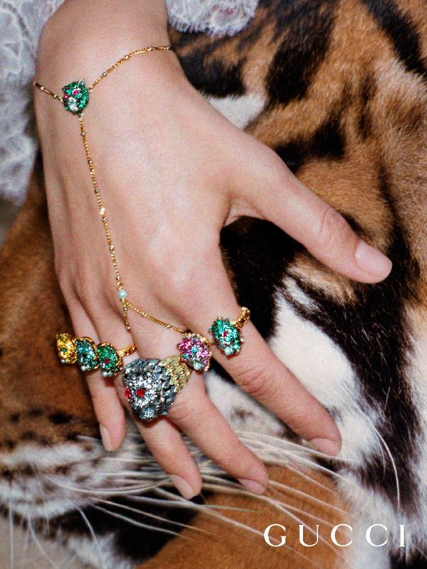 From the Gucci Spring Summer 2017 campaign: a hand bracelet and feline head multi-finger rings enriched by gemstones, part of the Le Marché des Merveilles fine jewelry collection.