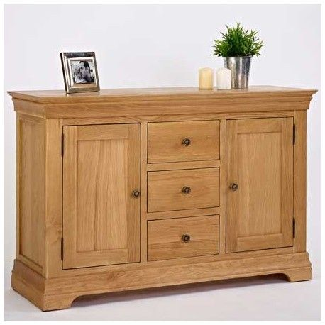 This Oak Sideboard 3 Drawer 2 Door is a stylish contemporary solid oak. This Oak sideboard has two cupboards and 3 drawers providing ample storage space to suit your needs. The drawers have dovetailed joints and plinth detailing. Made of solid oak. This Oak Furniture is ideal for the Living room, Dining Room, or Kitchen.