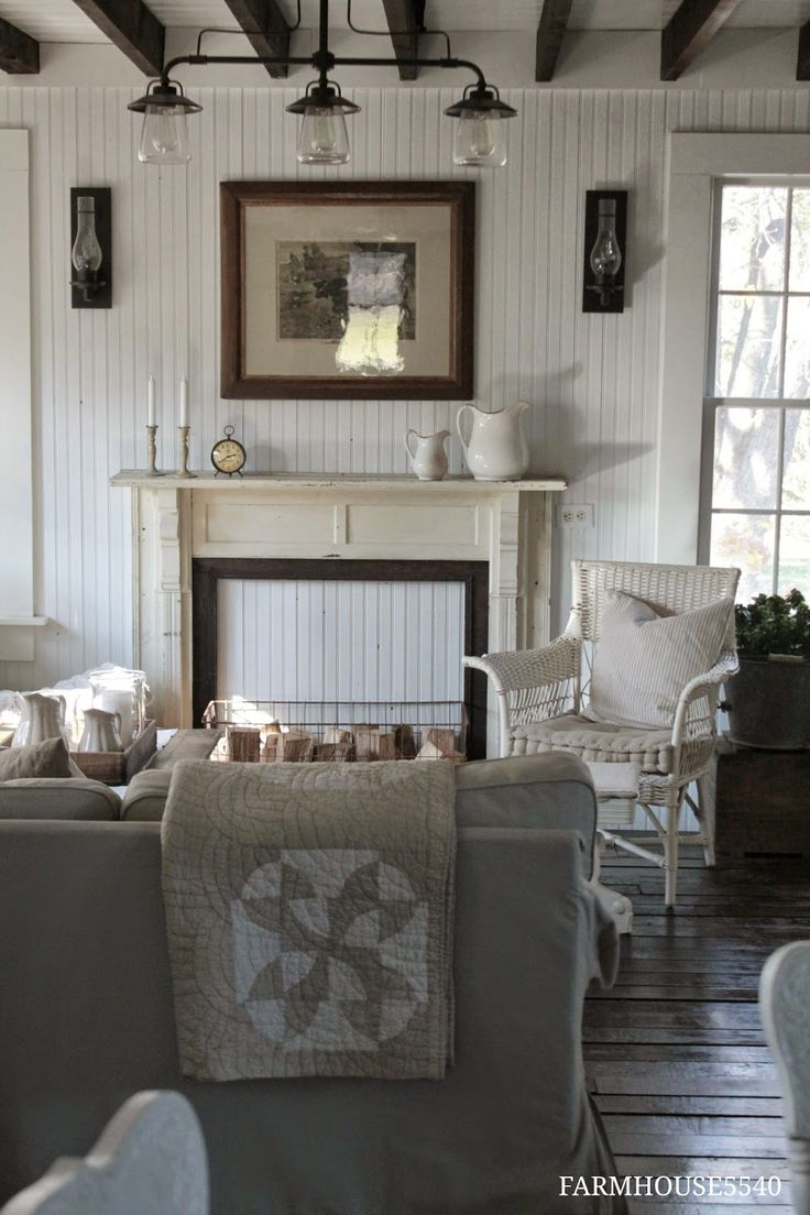 LIVING ROOM & FAMILY ROOM – farmhouse style with beamed ceiling and vintage fireplace.