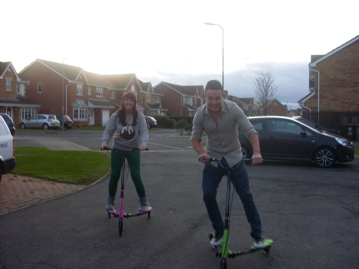 Playing on Scooters, its a childish occupation but riding round the street on flicker scooters is fun and makes me laugh.