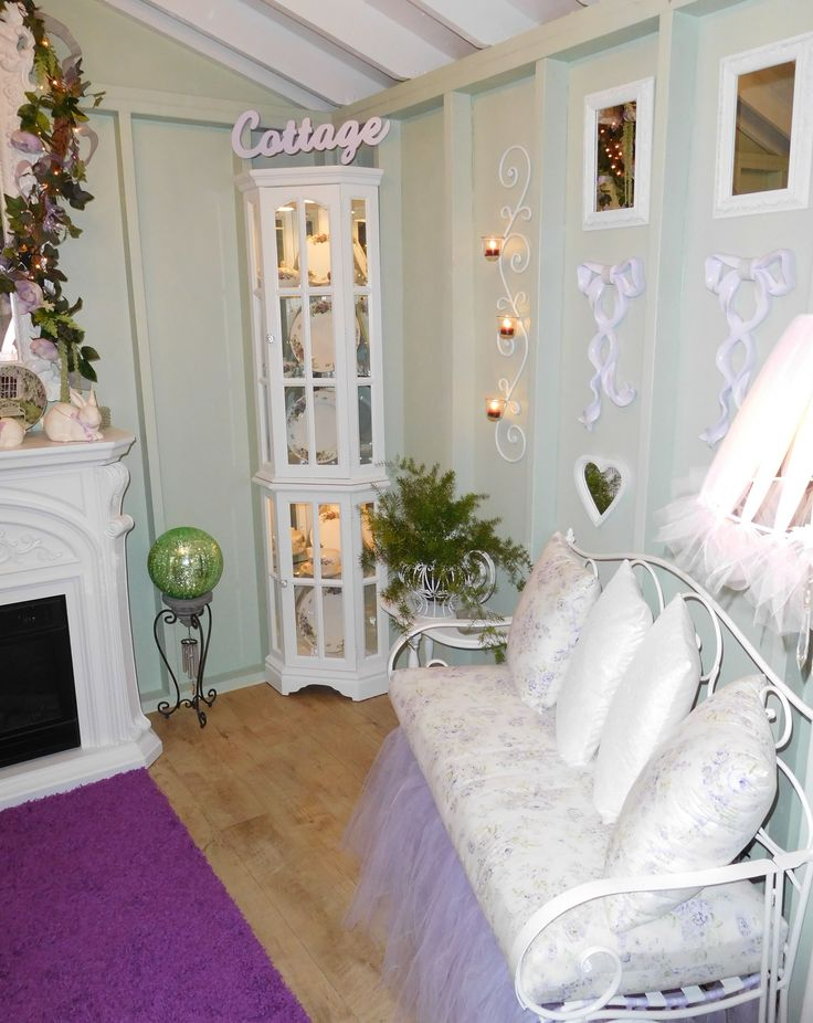 china cabinet and love seat inside a romantic she shed ....♥♥...