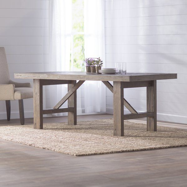 High class coastal style finds a home in Laurel Foundry's Kara Collection. The sandblasted bases for the tables are complimented perfectly trestle table for a solid wood look.