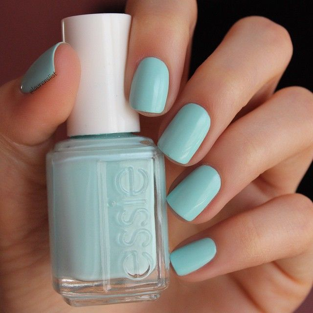 Sweeten up your day with a green 'mint candy apple' manicure.