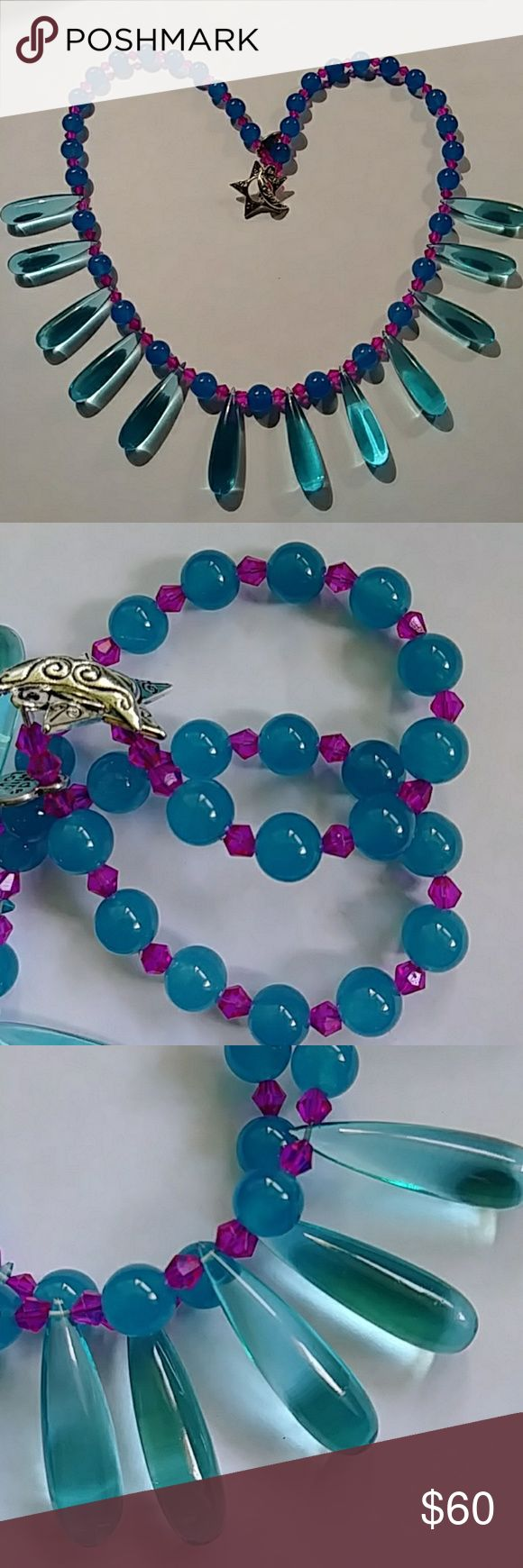 """Agate & Hydro Quartz Feeling colorful? Well then this may be the piece for you! Gorgeous pearls of bright blue Agate and sparkling bright pink bicones accent beautiful ice blue crocodile tears of lab grown Hydro Quartz. Measures 21"""" and finished with a pretty sun/moon toggle clasp. Quartz tear drops are 1 1/4"""" L. Handmade **photos give Agate pearls a purple-ish hue. They are best represented in pics 2,3 & 4. ** Handmade by Me Jewelry Necklaces"""