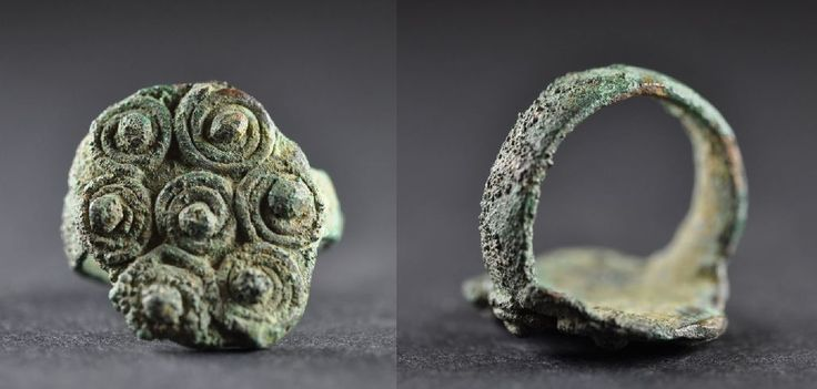 Amlash bronze ring with spirals 8, 1st millenium B.C. Amlash bronze ring with spirals, 2.4 cm long bezel, 1.9 cm diameter ring size, 8.8 gr weight. Private collection
