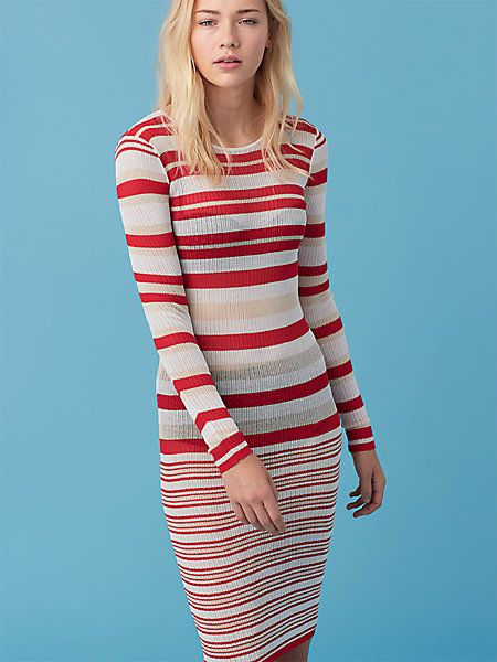 Easy to pack and endlessly flattering, this breathable knit dress transitions easily from beach to sunset cocktails.