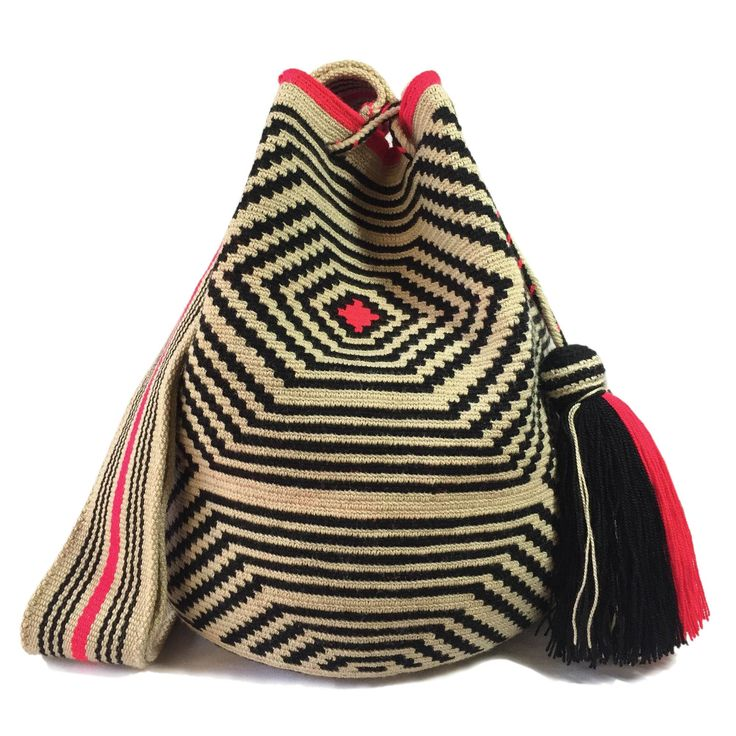 www.lombiaandco.com  The colors of this mochila Wayuu was inspired by the vivid colors that surround region of La Guajira. Sand, sea, desert, sun and a clear sky are constants in the landscape. Geometric figures are a signature ofthese mochila bags. #wayuubag