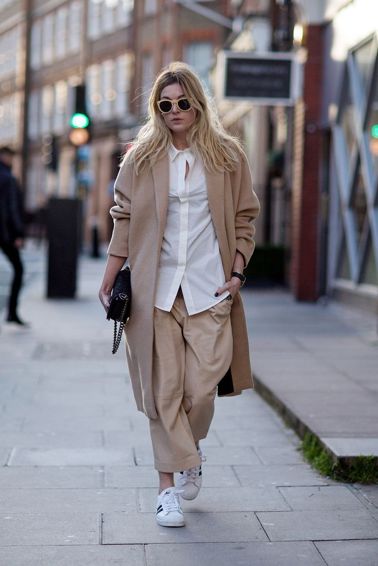 Is This The End Of Skinny Jeans? #refinery29  http://www.refinery29.com/baggy-pants#slide4  A relaxed, white shirt and adidas shell-toe shoes create a combo that would make Phoebe Philo proud.