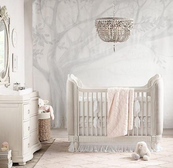 This gorgeous wall mural in the softest shades of grey, provides the perfect backdrop for a dreamy and sophisticated nursery. The oversized chandelier and crisp white furnishings complete the look.