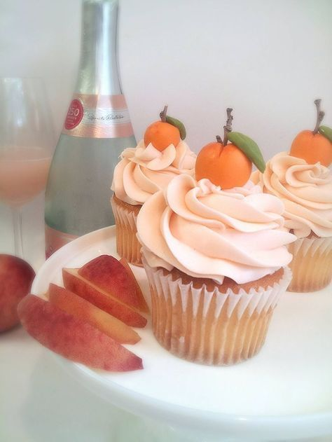 """These Peach Cupcakes with champagne Italian meringue are on my """"To Make ASAP"""" List. Recipe for the cupcakes: http://sweetannieskitchenblog.wordpress.com/2013/06/04/peach-cupcakes-with-peach-buttercream/ Icing: http://thefrostedcakeshop.tumblr.com/post/18905864806/frosting-101-italian-meringue-buttercream Substitute 1/2 champagne for water in the icing"""