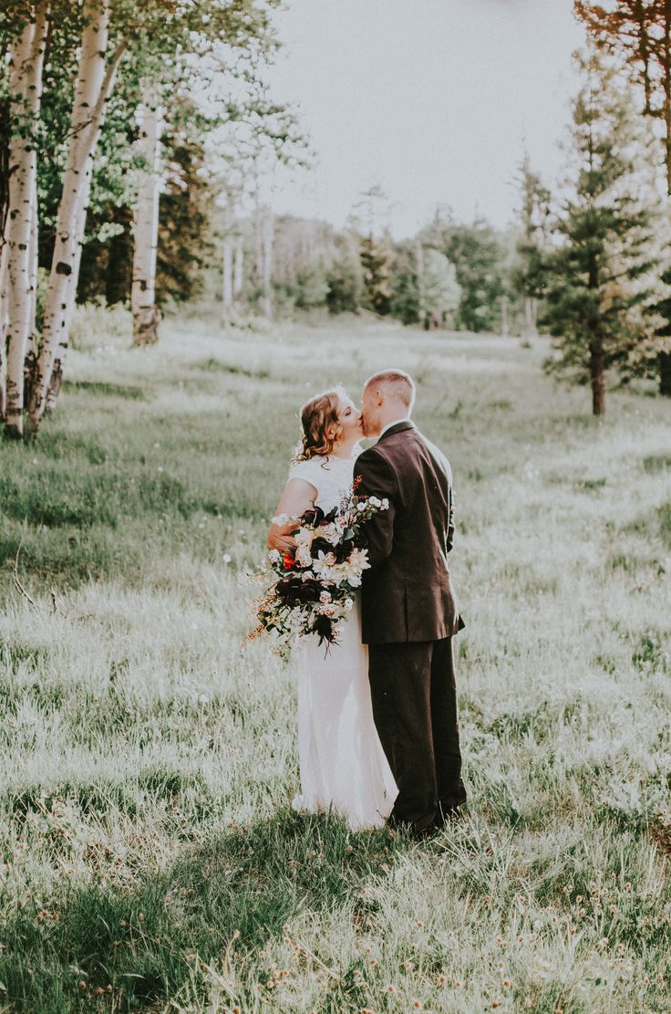 Mountain elopement ideas and inspiration. This mountain elopement was surrounded by love and pines. Photos by Simply Amor Photography