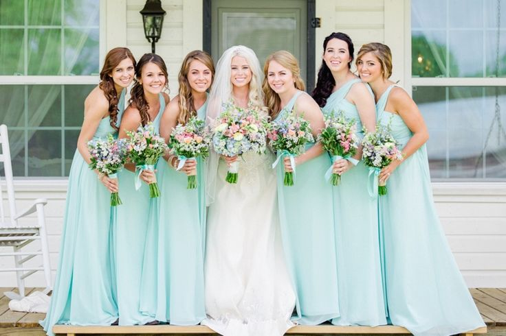 Aqua bridesmaid dresses | A Colorful Country Barn Wedding via TheELD.com