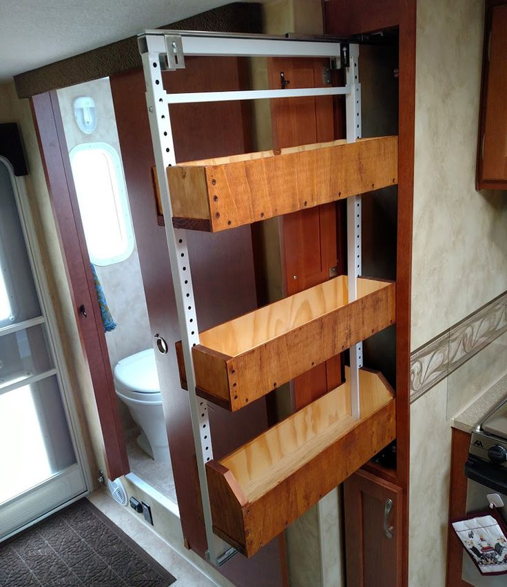 Wooden sliding pantry modification, Arctic Fox 1150, http://www.truckcampermagazine.com/expeditions/united-states/hops-across-america-rv-microbrewery-tour/