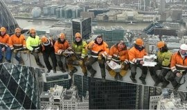'Lunch Atop a Skyscraper' – 2011 version of construction's most famous photo has been recreated by workers during the construction of Heron Tower, London.  Of course, they made sure they were safe whilst eating their lunch at 800ft, by wearing harnesses and being connected via lanyards!
