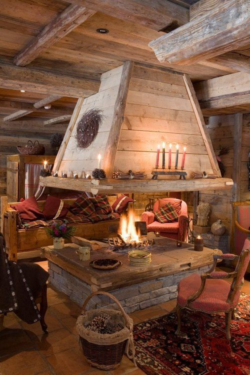 Amazing open fire place! This would be a fun place for a rustic Christmas at the cabin with the family.