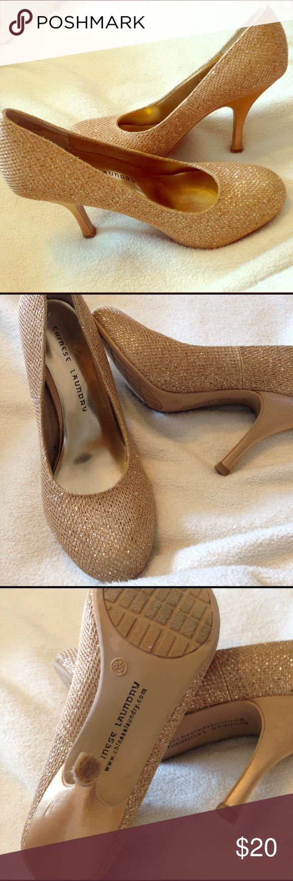 Sparkly gold heels Shimmery gold heels. Great for dressing up jeans or worn with the little black dress. Enjoy! Chinese Laundry Shoes Heels