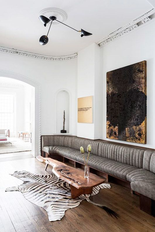 long banquette, zebra rug, organic wood table, by ash & leandro