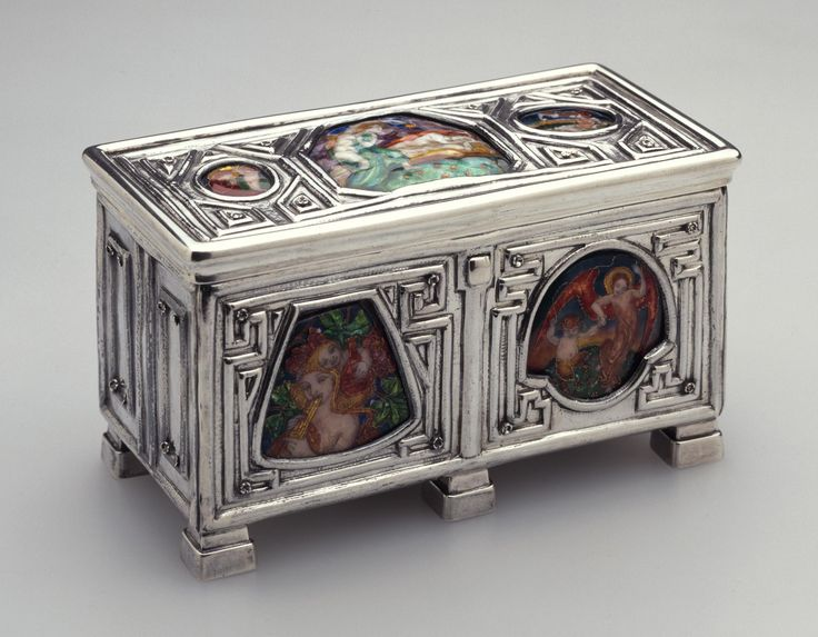 Rectangular silver writing casket on four feet, mounted with seven enamels, with wood lining and dividers: Scottish, Edinburgh, by Brook and Son, designed and with enamels by Phoebe Traquair, 1927 - 1928