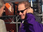 LSU coach Les Miles gets game ball for victory against Ole Miss the night after his mother passes away.