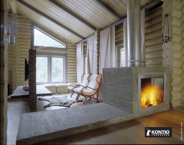 Grande cheminée dans un chalet en rondin Kontio.  http://www.kontio.fr/