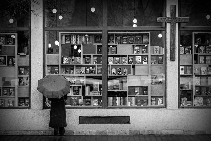 The book shop, the cross and the umbrella. Cluj-Napoca, Romania, 2015. Original, limited edition, signed, fine art print on Hahnemühle high quality paper. #streetphotography #blackandwhite #street #photography #fineart #print #urban #monochrome #night #graphic #cluj #symmetry