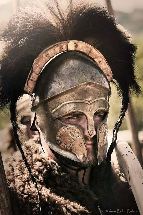 Hoplite with a highly decorated Corinthian helmet. (re-enactment)