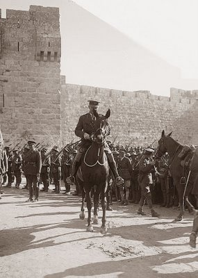 Photograph of General Allenby as he enters Jerusalem. The photograph was taken in December 11, 1917. He is pictured at the Jaffa Gate. Allenby's success was due in large part to the efforts of T.E. Lawrence, AKA Lawrence of Arabia.
