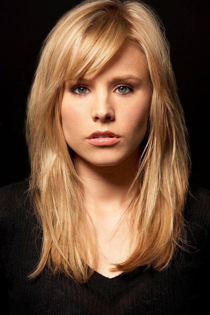 Actress Kristen Bell embraces her square face shape and wears her hair combed back into a flirty bubble fringe. Description from…