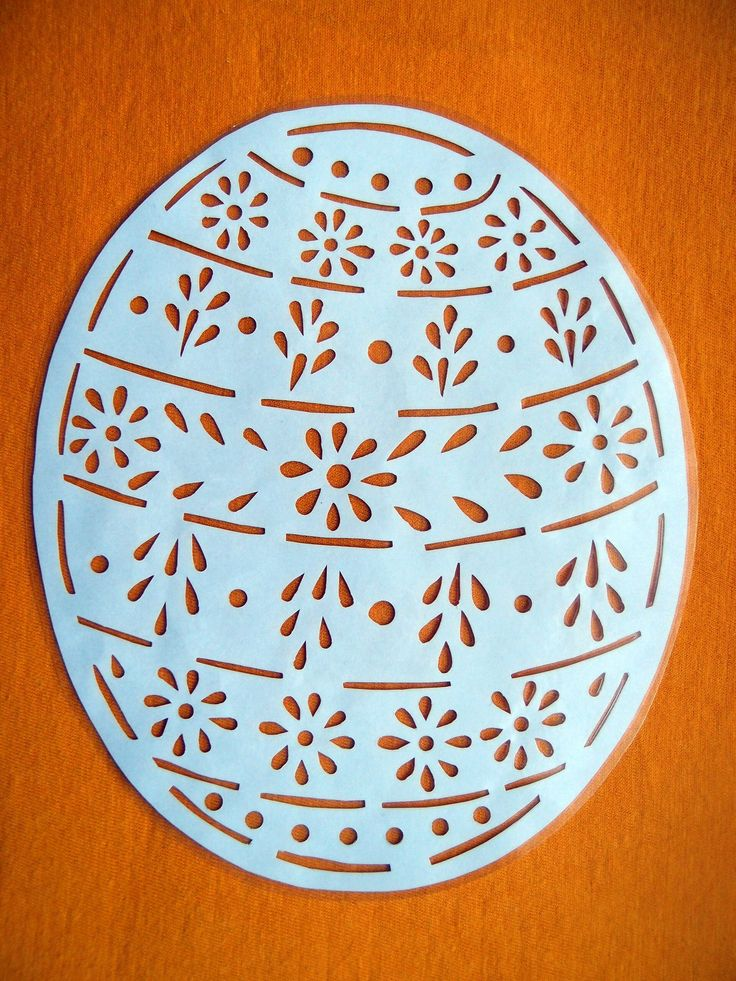 Velikonoční vystřihovánka - Kraslice Papírová vystřihovánka zatavená ve folii - pro opakované použití. Velikost vystřihovánky (i s folií) 16,5 x20 cm. Vhodné např. jako výzdoba do okna.