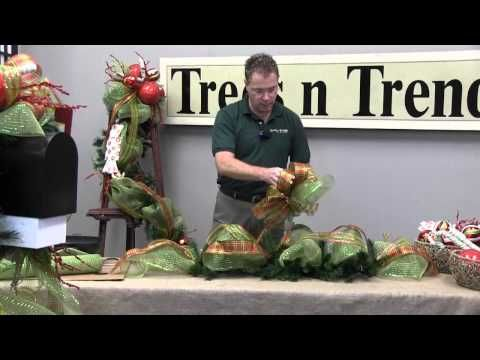 Kevin from Trees n Trends will show you how to decorate your mailbox for Christmas with a beautiful Christmas garland. In this video he explains some simple but effective design techniques that will help you decorate your mailbox. Trees n Trends - Unique Home Decor. Follow us on Facebook at http://www.facebook.com/treesntrends Visit our websit...