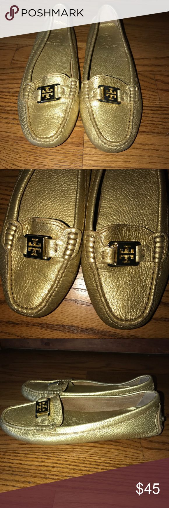 Tory Burch Driving Loafer Tory Burch driving loafer in a gold color.  These shoes have been worn and have a little scuffing of the leather in the front of both shoes, which is shown in the pictures.  The scuffs are not noticeable when shoes are on.  Size 7.5. Tory Burch Shoes Flats & Loafers