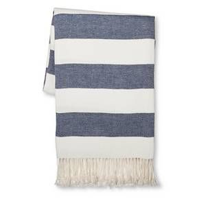 """For the perfect finishing touch and a gorgeous accent piece, get the Threshold Stripe Throw Blanket. This throw is made of 100% cotton and is machine washable. The blanket measures 60""""x50"""" and has wide uniform stripes with tassels for an attractive look."""