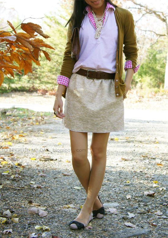 Stitch fix stylist: I like the style of this skirt. I like the pink shirt underneath the pull over sweater.
