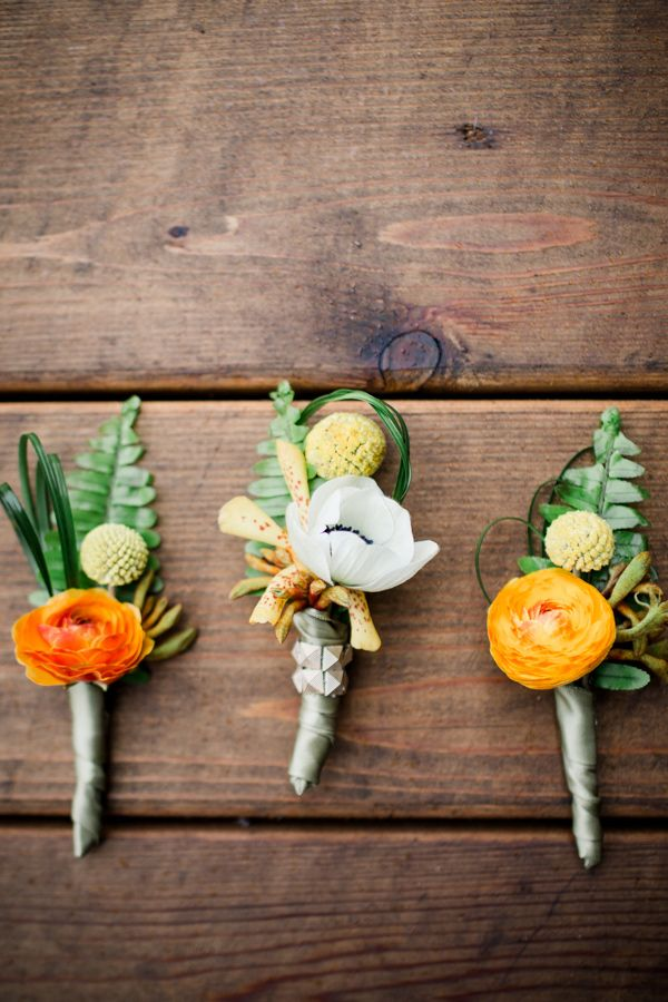 orange boutonnieres - photo by Grey to Blue Photography http://ruffledblog.com/tropical-west-coast-inspired-wedding