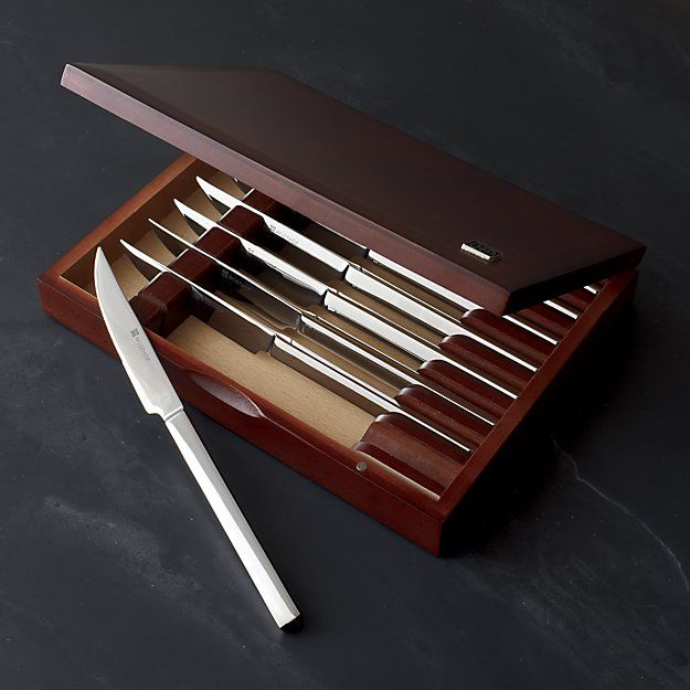 The sleekest steak knives combine the renowned quality and craftsmanship of Wüsthof with a contemporary stainless design that's the ultimate in utility. Eight knives with linear, polished handles and laser-cut, high-carbon stainless steel serrated blades nestle in a handsome wood presentation box with rosewood finish.
