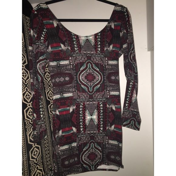 Multi color Pattern Dress Funky tribal-ish pattern. Red, teal, grey, black, white. Pretty stretchy. Says L but could definitely fit a medium as well. Cute going out dress Dresses Long Sleeve