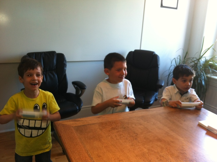 Children of the herd playing WII in the meeting room.