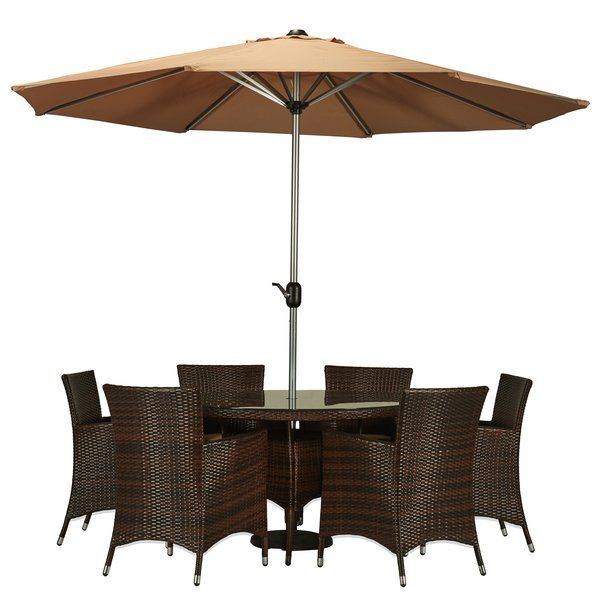 Craft an outdoor oasis with this stylish dining set, showcasing a woven design, 6 chairs, a table, and an umbrella. Top it with blue serveware and a seashell filled cloche for a pop of beach-chic style.