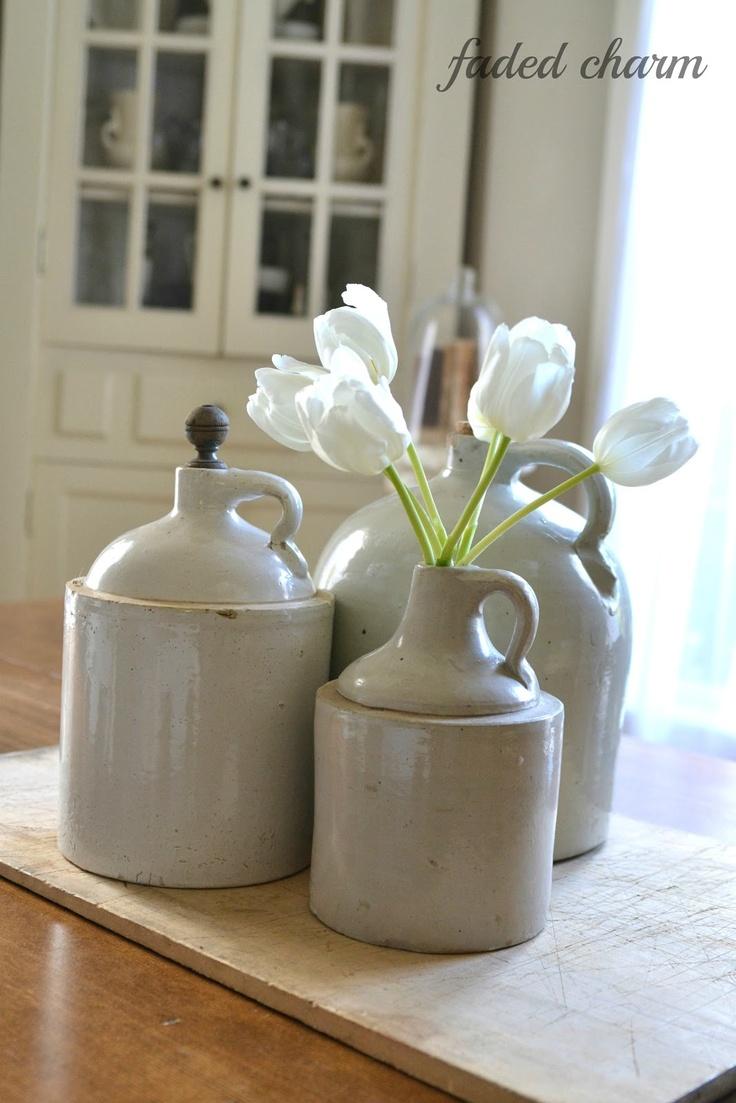 Old salt glazed jug used as a flower vase