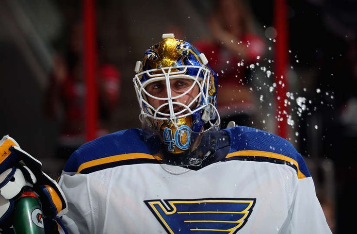 RALEIGH, NC - OCTOBER 27: Carter Hutton #40 of the St. Louis Blues splashes some water during a break in the action of an NHL game against the Carolina Hurricanes of the St. Louis Blues during an NHL Carter game on October 27, 2017 at PNC Arena in Raleigh, North Carolina. (Photo by Gregg Forwerck/NHLI via Getty Images)