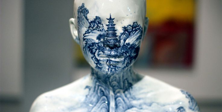 Traditional porcelain patterns on life-sized human busts.