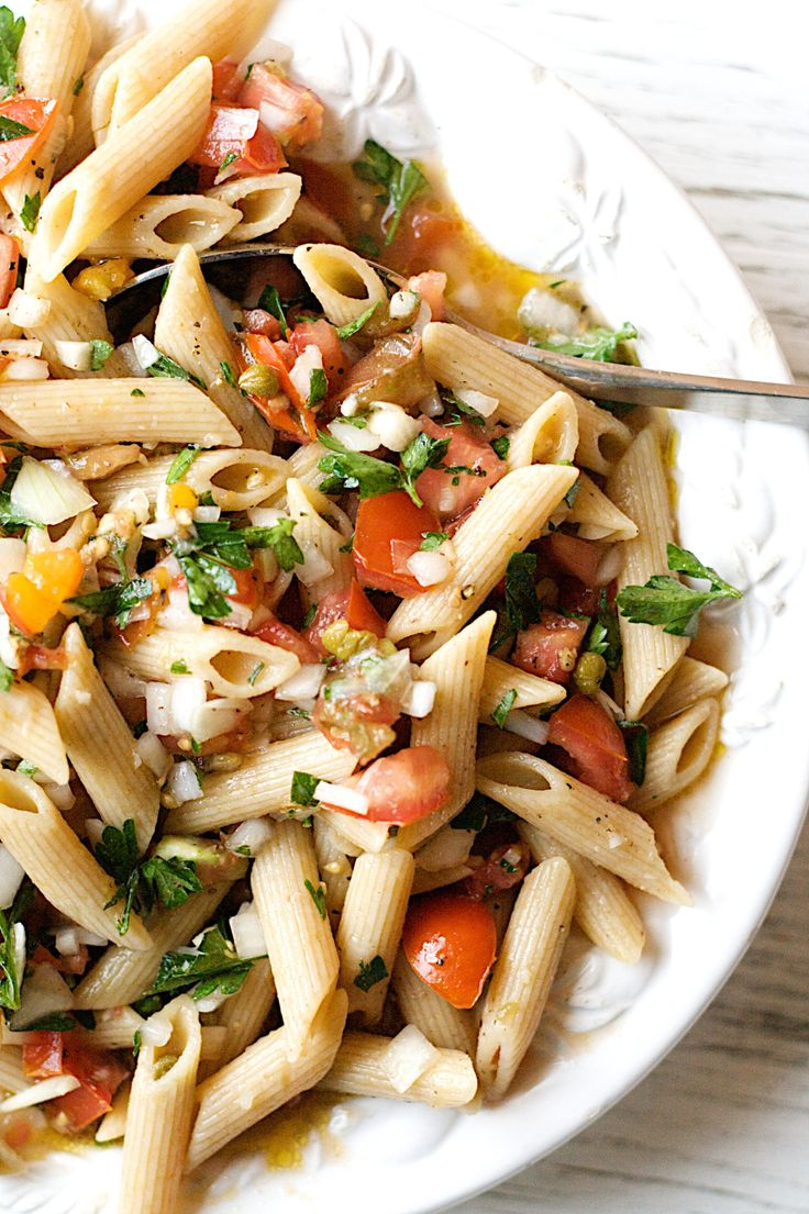Pasta with garlic, lemon, and tomato.