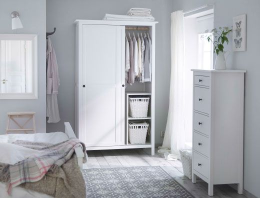 A traditional white bedroom with HEMNES wardrobe and chest of drawers in white