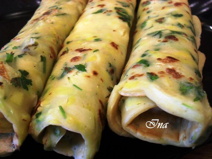 Reteta culinara Clatite cu dovlecei din categoria Aperitive / Garnituri. Specific Romania. Cum sa faci Clatite cu dovlecei