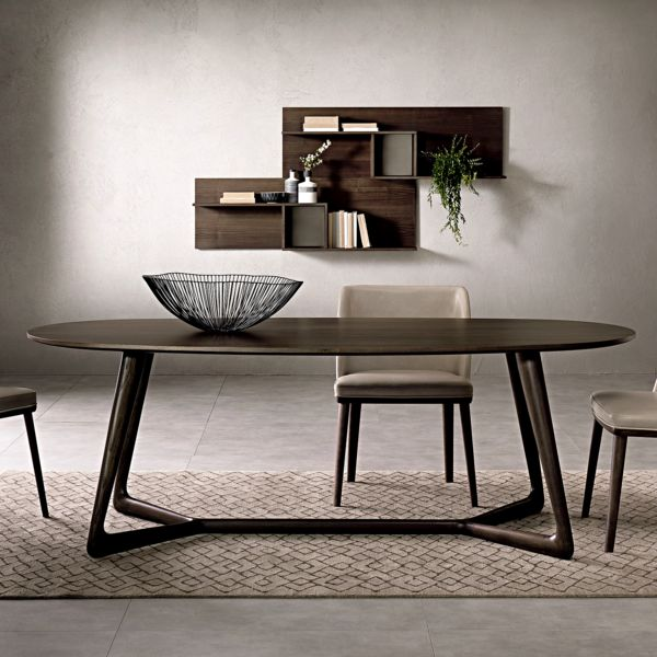 The Cover dining table is made in Italy by highly renowned Pacini e Cappellini. The sleek oval surface sits atop a distinctive base in solid ash, with a selection of sizes and finishes available.