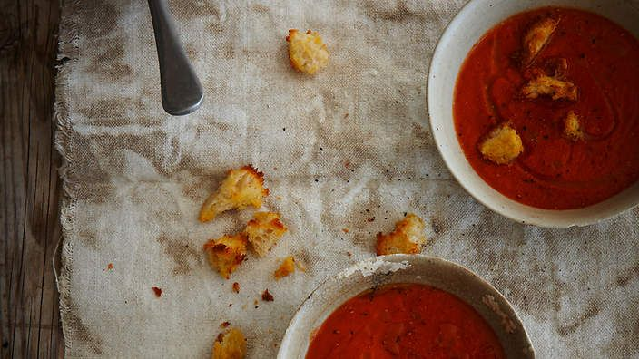 Slow-roasted tomato and capsicum soup with sour dough croutons recipe from the food dept. (recipe by Sally Courtney, photography by Petrina Tinslay, styling by David Morgan and art direction by Anne Marie Cummins).