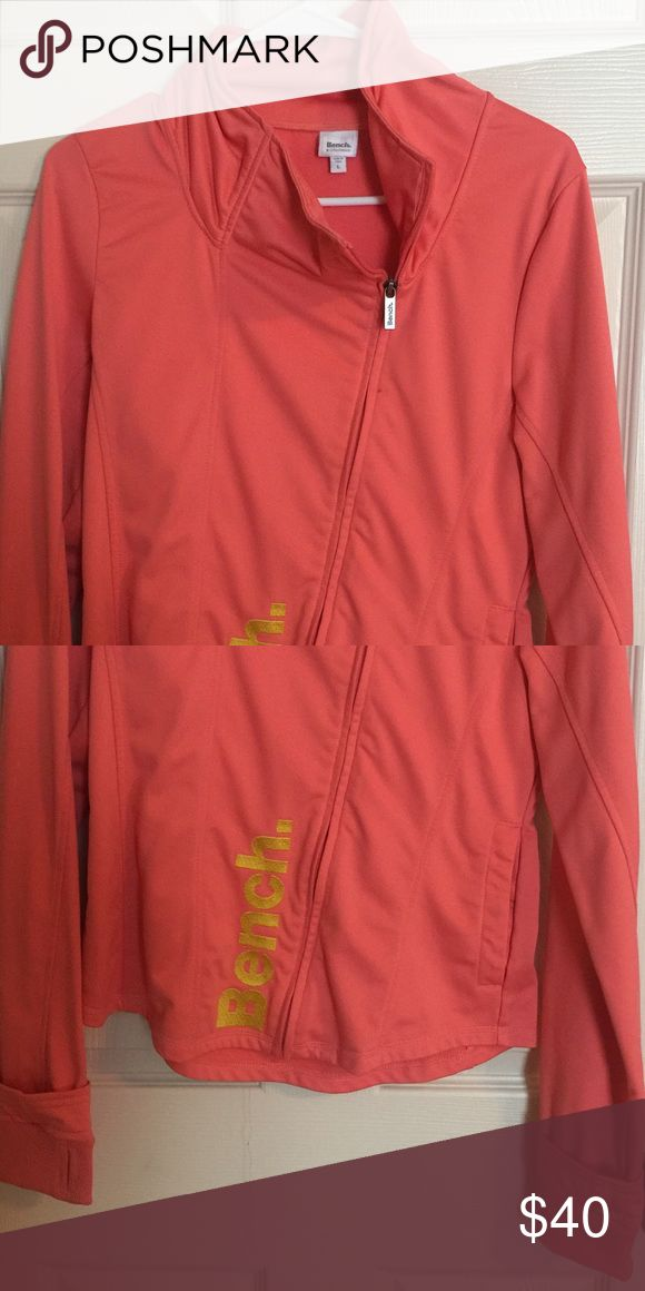 Bench Jacket Lite jacket with slanted zipper and thumb holes. *coral/ orange color Bench Jackets & Coats